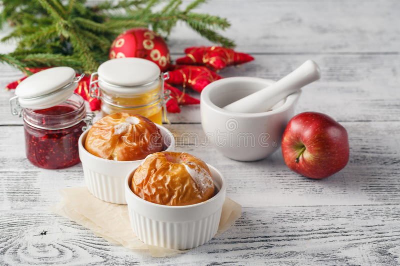 Christmas background of homemade oven baked apples, spices, nuts stock photography