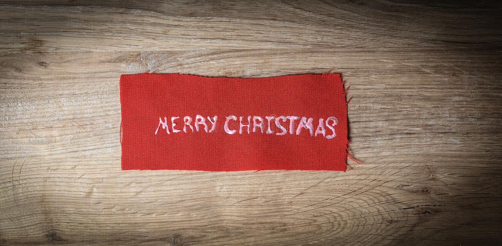 Christmas background. the inscription merry Christmas on wooden stock photos