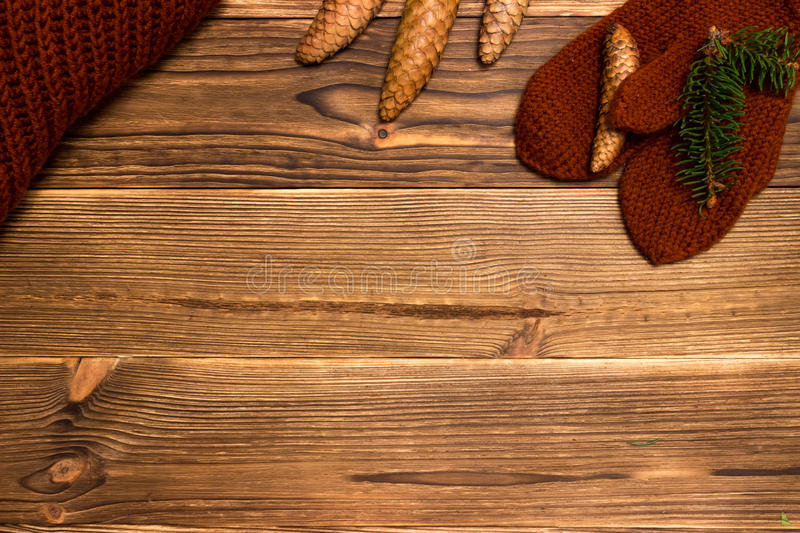 Christmas background with knitted mittens and a cup of coffee stock image
