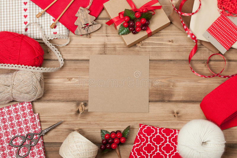 Christmas Background. Knitting And Sewing Kit. Natural Wool Yarn, Linen Textile. Wooden Table With Copy Space royalty free stock image