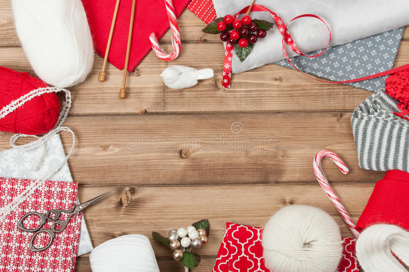 Christmas Background. Knitting And Sewing Kit. Natural Wool Yarn, Linen Textile. Wooden Table With Copy Space royalty free stock images