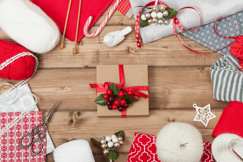Christmas Background. Knitting And Sewing Kit. Natural Wool Yarn, Linen Textile. Wooden Table With Copy Space royalty free stock photo