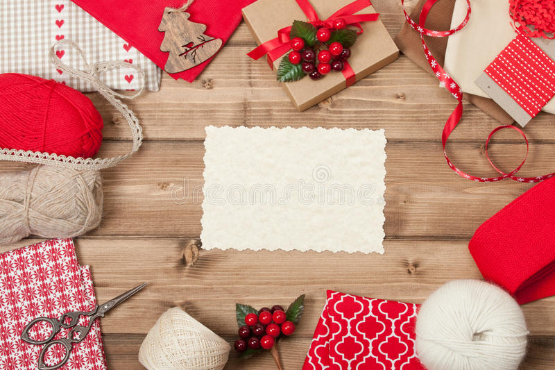 Christmas Background. Knitting And Sewing Kit. Natural Wool Yarn, Linen Textile. Wooden Table With Copy Space stock image