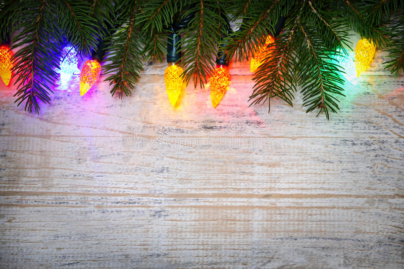 Download Christmas Background With Lights On Branches Stock Photo - Image: 27996220