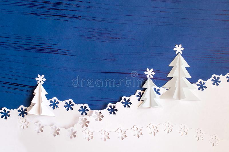 Christmas background made of paper with 3d Christmas trees and s. Bright Christmas background made of paper with 3d Christmas trees and snowflakes carved into stock images