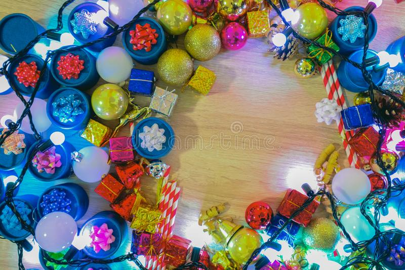 Christmas background, Merry Christmas greeting card idea colorful gifts and sparkle light bulb royalty free stock photos