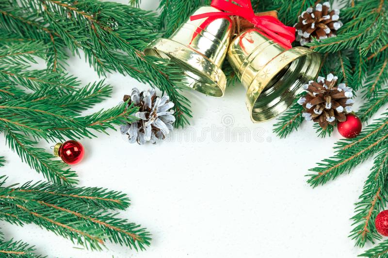 Christmas background. New Year`s background. Christmas jewelry on fir-tree branches, gold spheres, royalty free stock photos