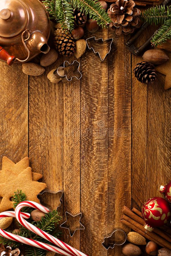 Christmas background with nuts, decorations and candy cane. Overhead shot stock photo