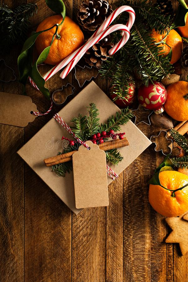 Christmas background with oranges, candy canes and decorations. Christmas background with oranges, candy canes, cookies and decorations and wrapped present stock image