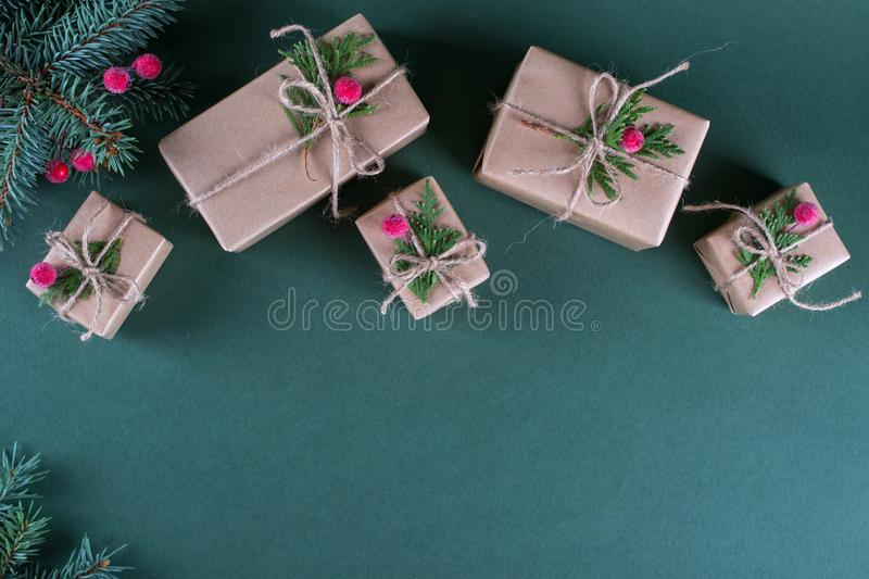 Christmas background. Packing gifts in vintage beige craft paper and natural decor. royalty free stock photo