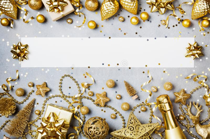 Christmas background with paper blank, gift or present box and golden holiday decoration top view. Flat lay royalty free stock photos