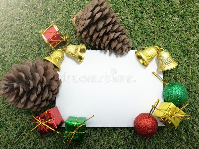 Christmas background pine cone gift boxes, bells and space for writing your message on green grass. Big, wooden, chair, sunrise, sea, bangsaen, thailand royalty free stock photo