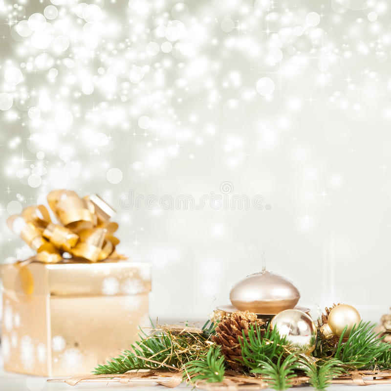 Christmas background with present box. Golden Christmas background with present box on snow stock images
