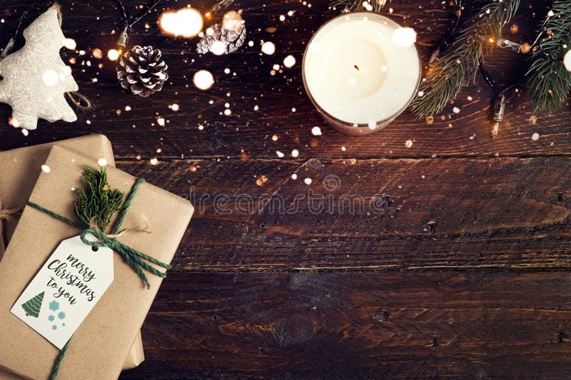 Christmas present gifts box and rustic decoration on vintage wooden background with snowflake stock photo