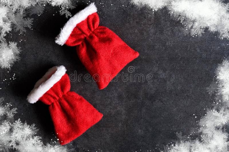 Christmas background. Red Christmas bags of gifts. On black background royalty free stock images