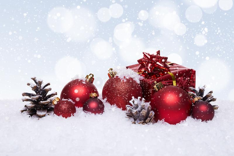 Christmas background with red balls on snow stock images