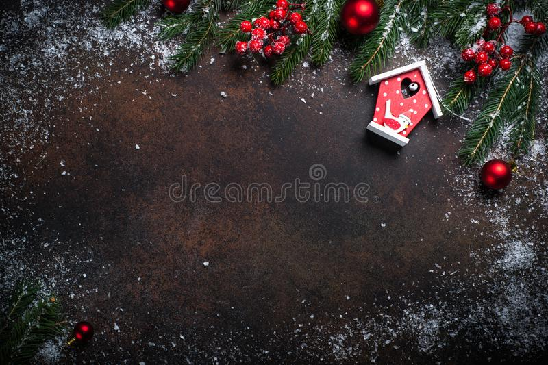 Christmas background with a red bird house. stock photography