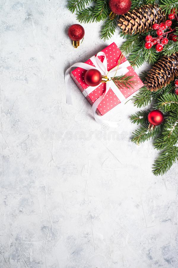 Red christmas present box, fir tree branch and decorations. stock photo