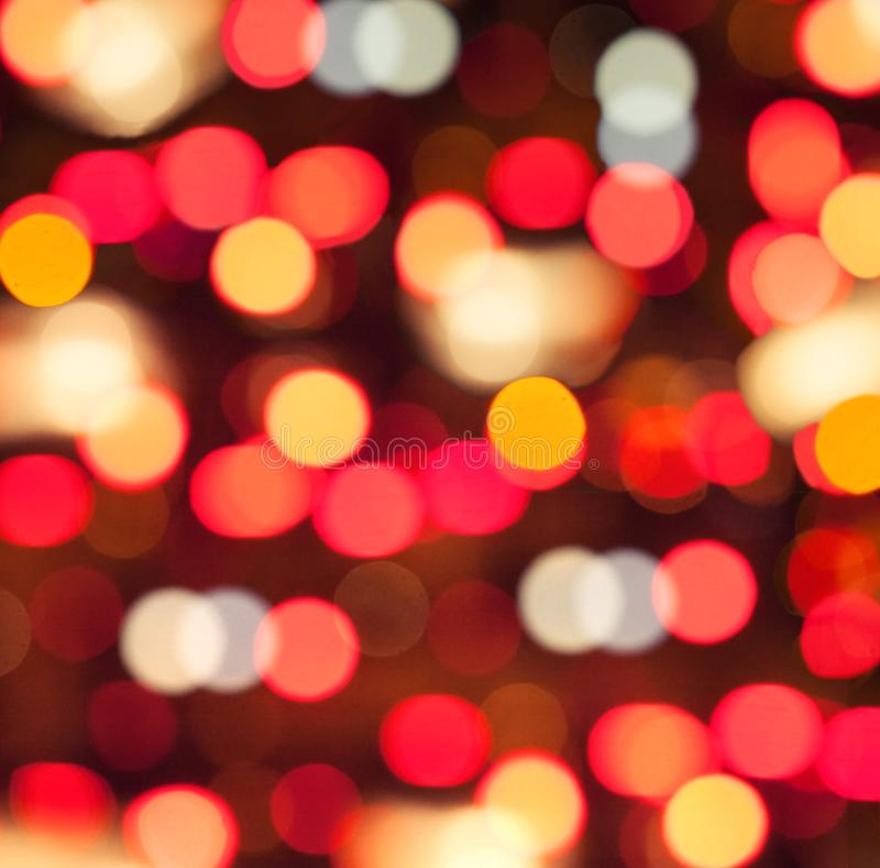 Christmas background with red and gold abstract bokeh glitter. And sparkle stock images