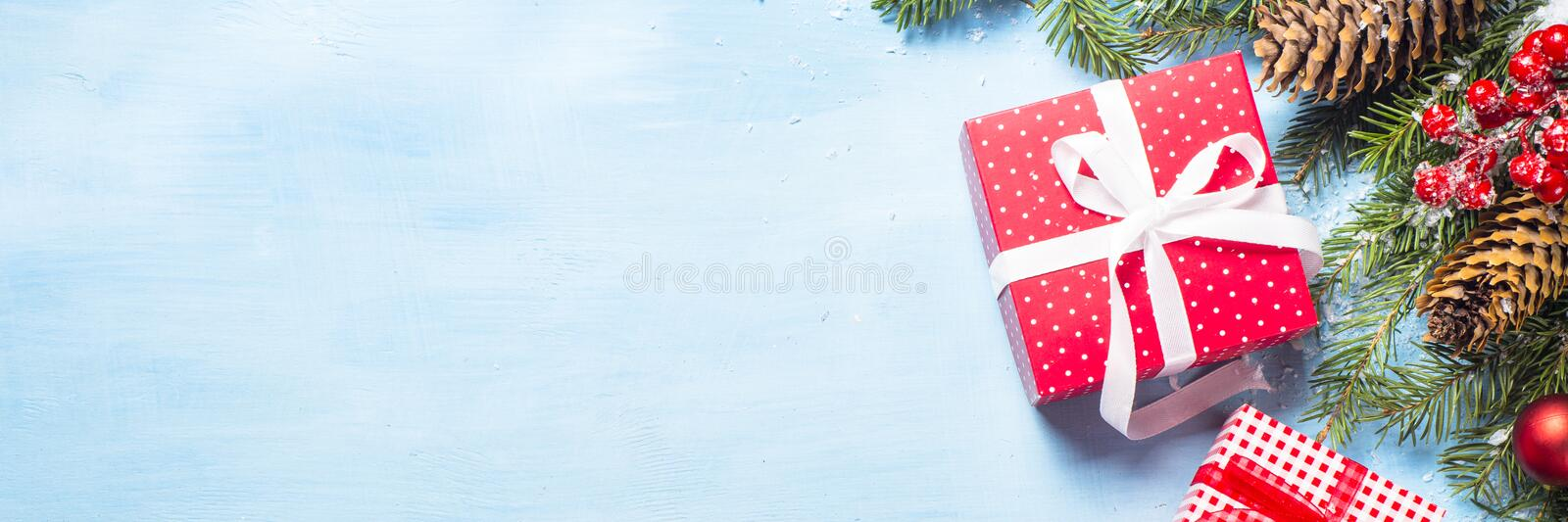 Christmas background on blue with present box and decorations. royalty free stock photography
