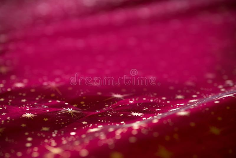 Christmas background red textile drapery with golden stars stock image
