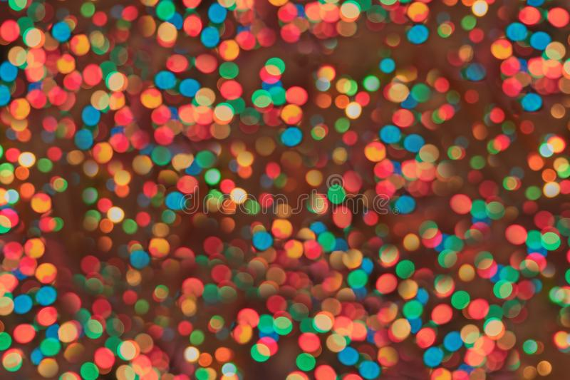 Christmas background with shiny light circles royalty free stock photography