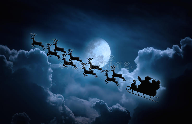 Christmas background. Silhouette of Santa Claus flying on a sleigh pulled by reindeer. Christmas background. Beautiful winter landscape with background of night royalty free stock images