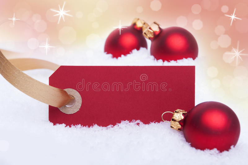 Christmas Background with Snow. A Red Label in the Snow as Christmas Background With Copy Space royalty free stock images