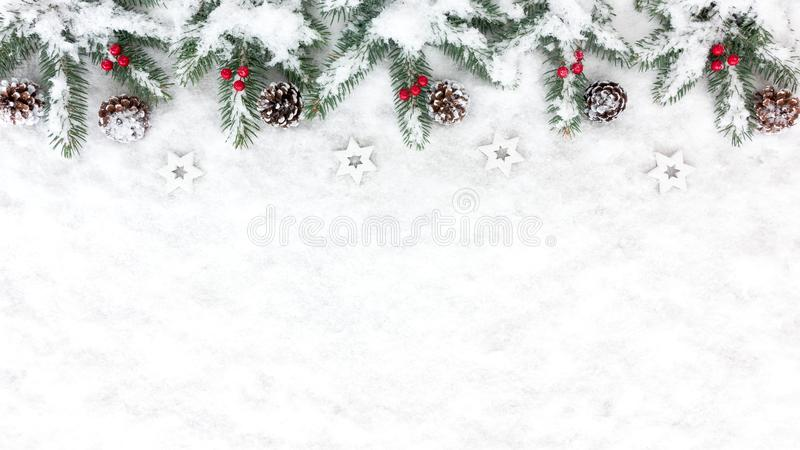 Christmas Background with Snow, Stars, Pine Cones and Fir Tree T stock image