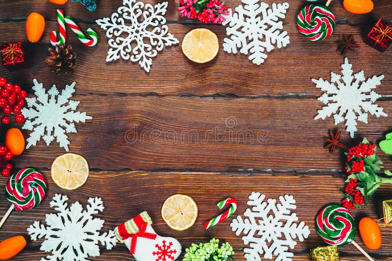Christmas frame with Christmas tree branches, ornaments, candy and decorations royalty free stock photos