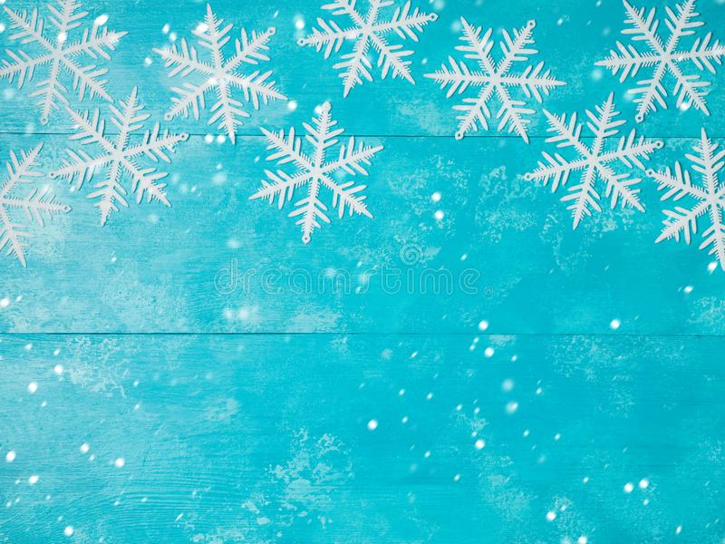 Christmas background with snowflakes. On wooden board. View from above. Flat lay royalty free stock image