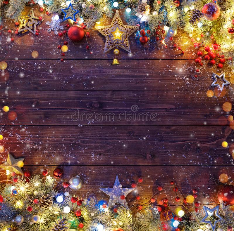 Christmas Background - Snowy Fir Branches And Lights stock photos