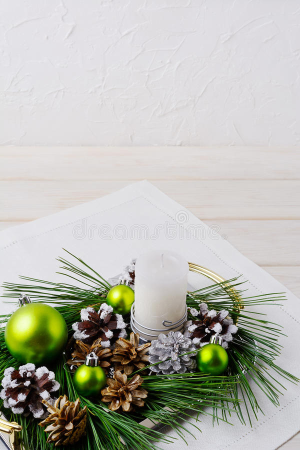 Christmas background with snowy pinecone and green ornaments. Christmas party decoration with shiny balls. Copy space royalty free stock image