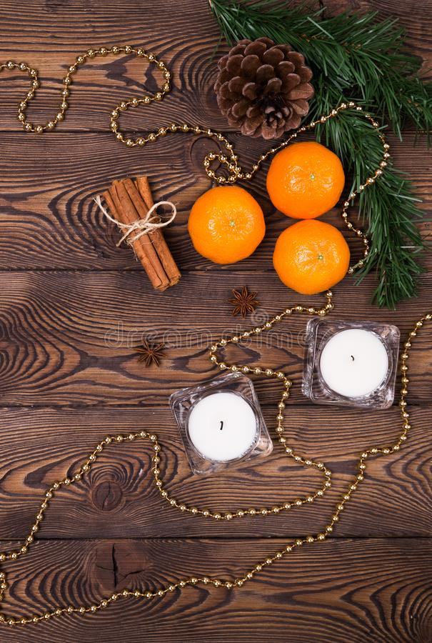 Christmas background - spruce branches with cones, mandarins cinnamon, star anise, Christmas decor. Flat lay, empty space stock photos