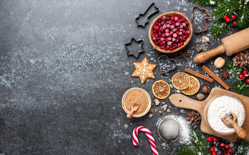 Christmas background. Table for holiday baking cookies with ingredients royalty free stock photo