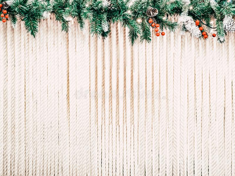 Christmas background for text. The rope stretched in rows is decorated with a hat made of Christmas tree ornaments stock photography
