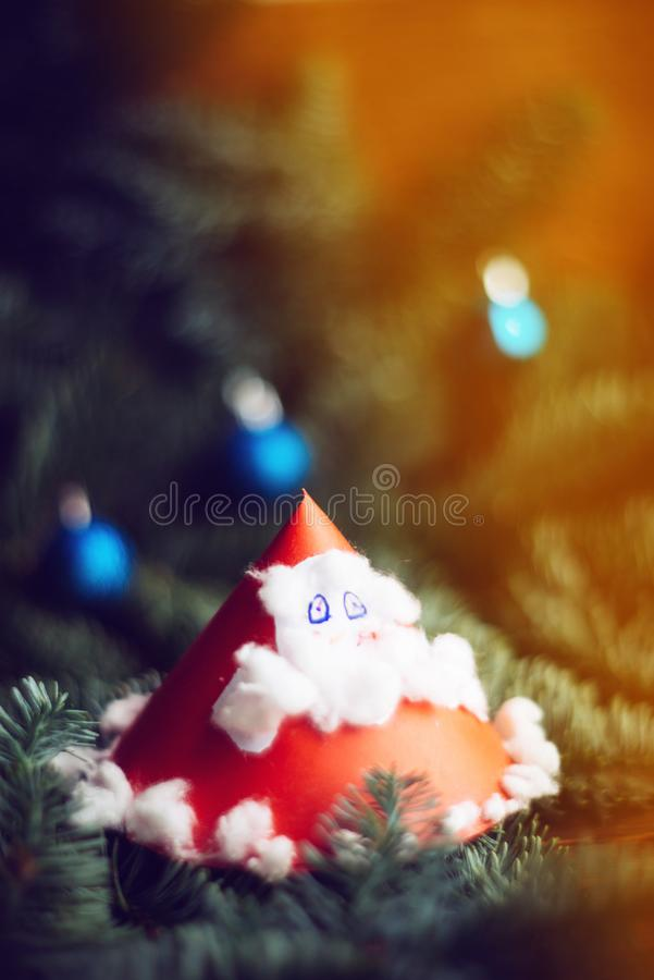 Child's painting of Santa Claus with bag. Christmas background, texture, substrate, layout: children's crafts from paper - Santa Claus with fir branches royalty free stock photos
