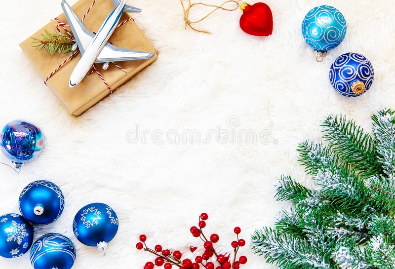 Christmas background on the theme of travel. The plane symbolizes the gift of the journey. Selective focus. royalty free stock images