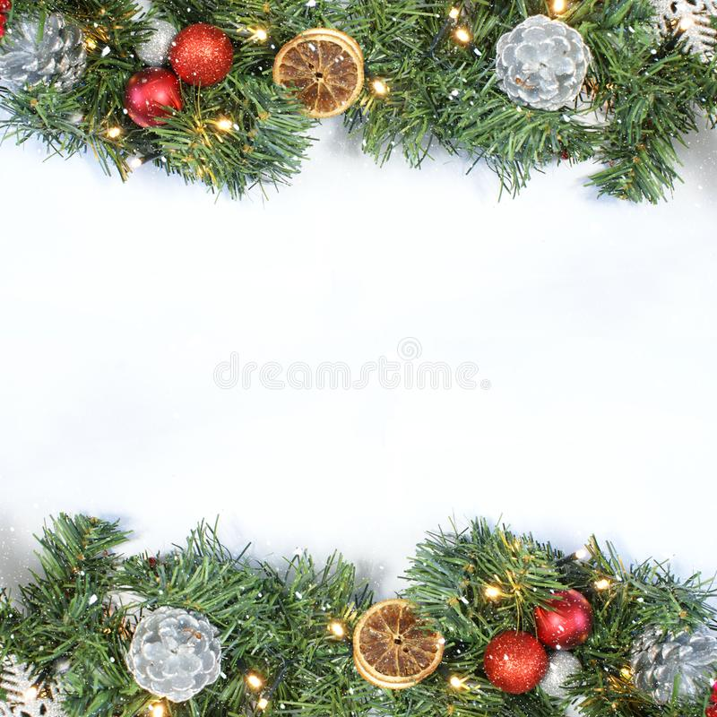 Christmas background with top view of wreath, decorations and sn stock image