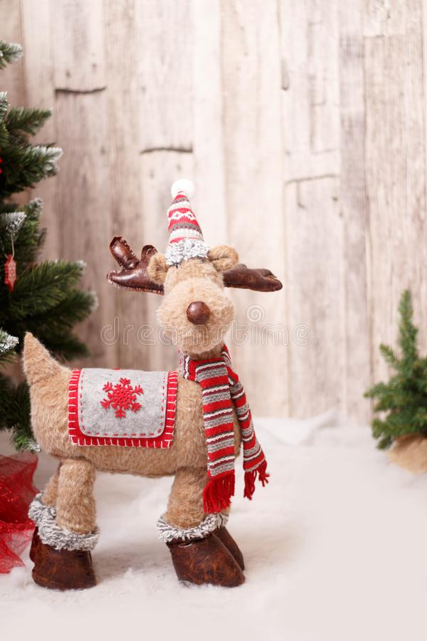 Christmas background toy deer - winter holiday. Toy Deer Christmas decoration - winter holiday background. Wood, Christmas tree and snow royalty free stock photo
