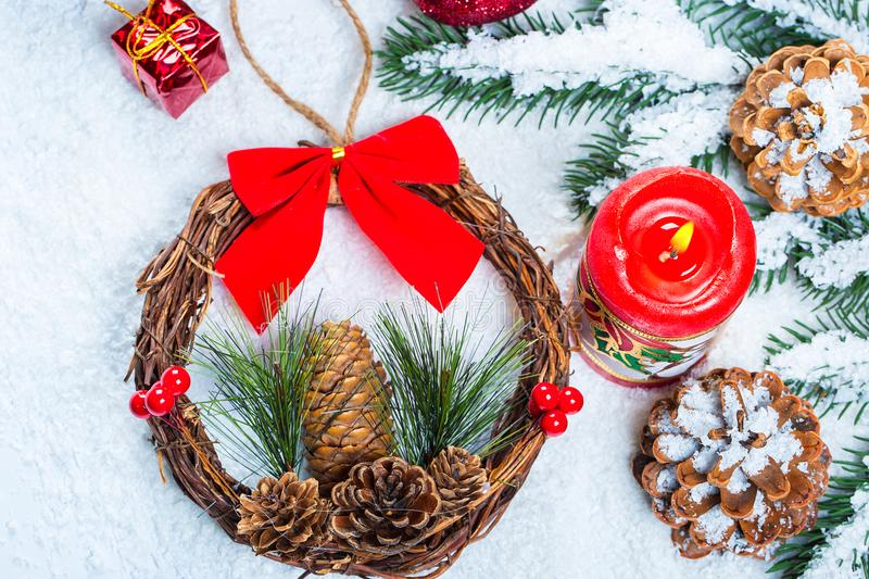 Christmas background with Christmas tree branches with a burning candle and wreath. Free space royalty free stock photography