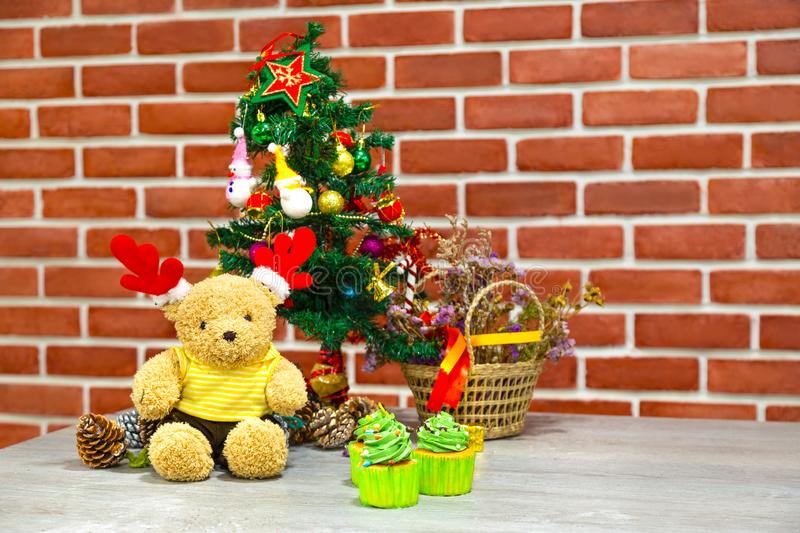Christmas background with christmas tree for home decoration toy. And teddy bear, snowman and cupcake in happy holiday concept stock photos