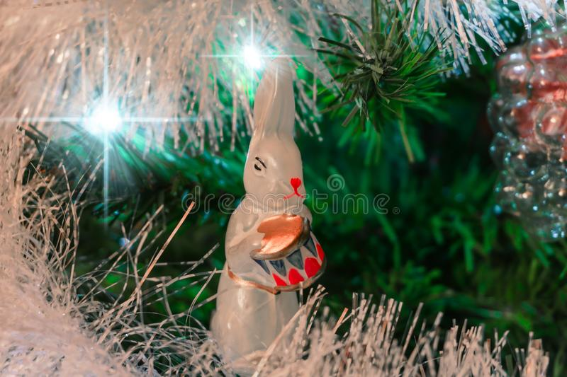 Christmas background with vintage christmas decoration. White hare with gold drum royalty free stock photo