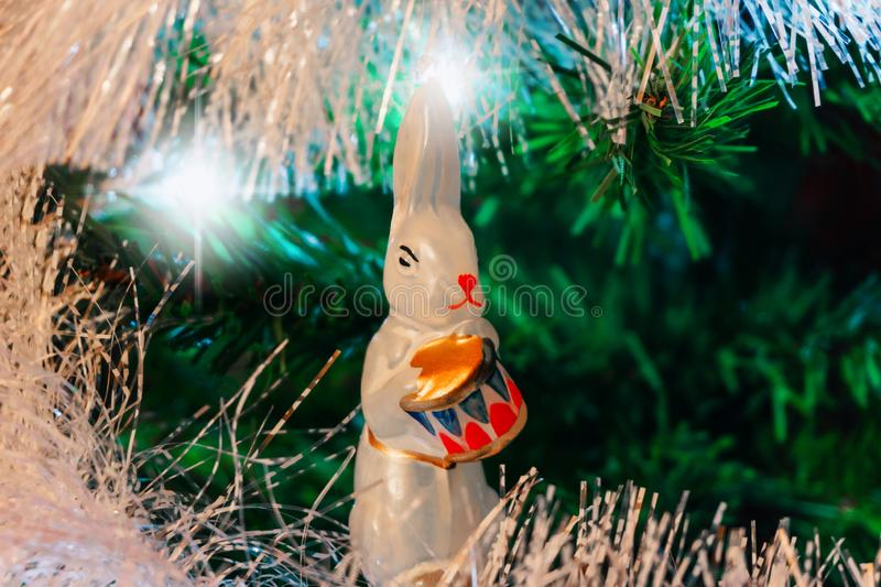 Christmas background with vintage christmas decoration. White hare with gold drum stock photos
