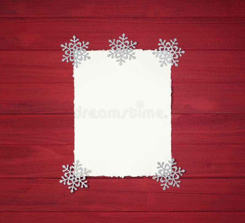 Christmas Background with Vintage Paper with ragged edges and Snowflake Decorations on Rustic, Shiplap Wood Boards with copy space stock photos