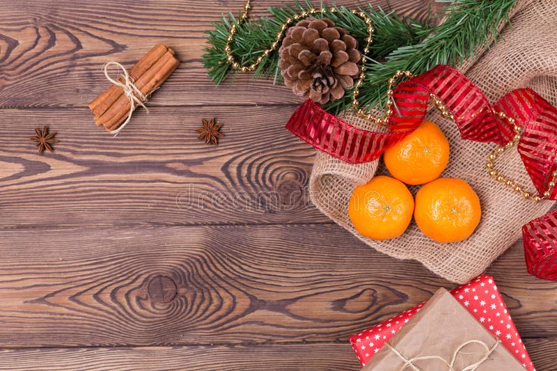 Christmas background - vintage wood, cinnamon, star anise, gifts and mandarins, a New Year`s decor.Top view, blank space royalty free stock photos