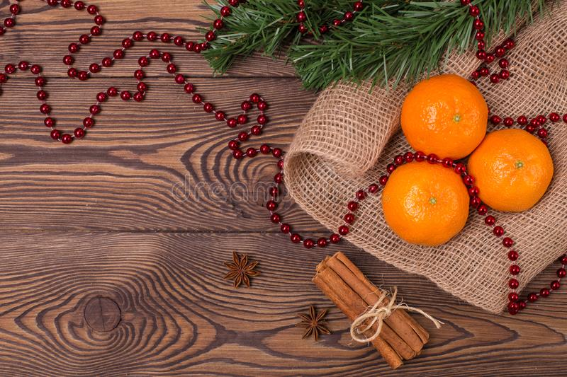 Christmas background - vintage wood, cinnamon, star anise, sweet mandarins, a New Year`s decor.Top view, blank space royalty free stock images