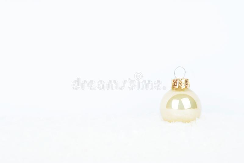 Christmas background with white christmas tree ball on glitter. stock photography