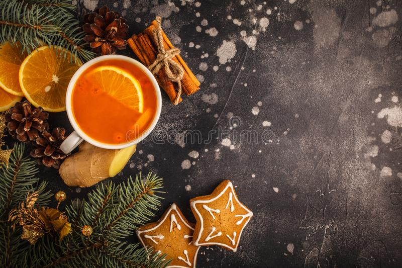 Christmas background. Sea-buckthorn tea with ginger and citrus royalty free stock images