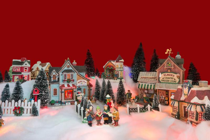 Christmas background of winter miniature scenery with kids royalty free stock photography